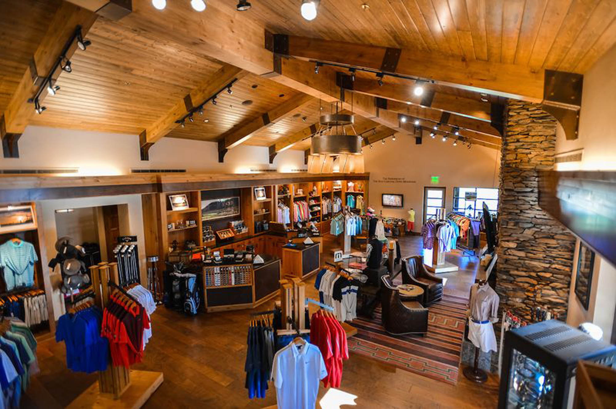 An interior shot of the Golf Shop shows a plethora of hardwood and brick accents